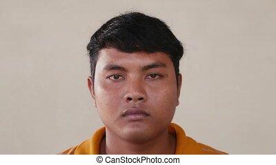 Sad young Asian man portrait