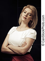 Sad young fashion blonde woman looking down