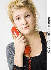 red telephone - sad young girl and vintage red telephone