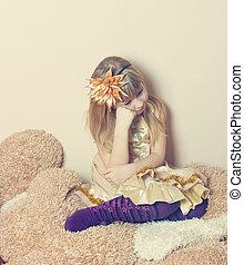 Sad young girl sitting