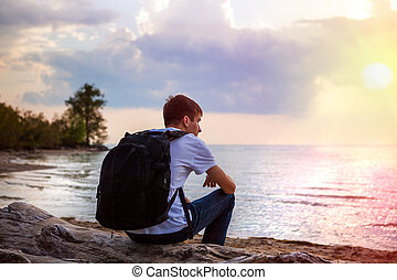 Sad Young Man at Seaside - Pensive Young Man on the shore at...