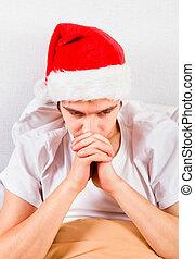 Sad Young Man in Santa Hat