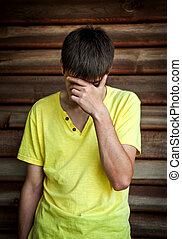 Sad Young Man outdoor - Sad Young Man by the Wooden Wall