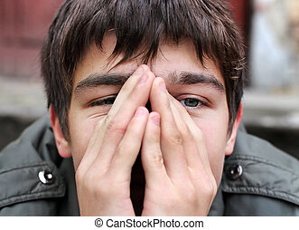 Sad young man outdoor - Sad Young Man Portrait closeup on...