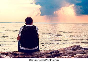 Sad Young Man - Toned Photo of a Sad Man sit on the Sea...