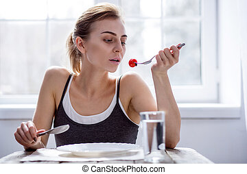 Sad young woman being on a diet