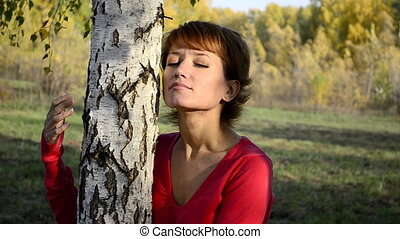 Sad young woman in autumn park