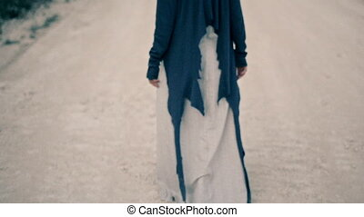 sad and unhappy young woman in ethnic clothes walks along the white road. Unrequited love.