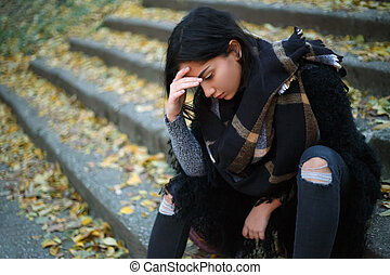Sad young woman outdoors