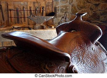 Saddle sitting in a barn