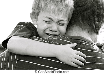 Sadness - Crying Boy being comforted by his father