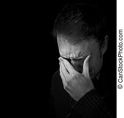 sadness, man crying black and white portrait with copy space