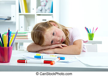 Sadness - Portrait of sad girl putting her head on desk