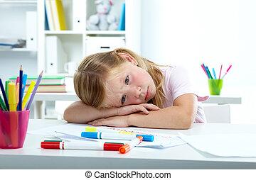 Sadness - Portrait of sad girl putting her head on desk