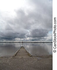 sadness - the gironde river under dark and grey sky