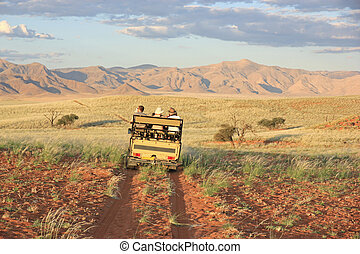 Safari in Namibia - A group of turists during a namibian...