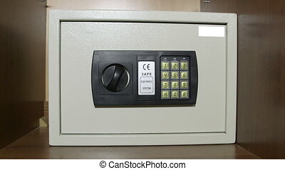 Safe box with digital lock hidden in wardrobe at home or hotel room
