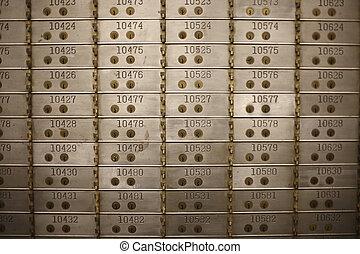 Safe deposit boxes in a bank vault.