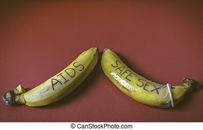 Safe sex concept of condom on banana for gay