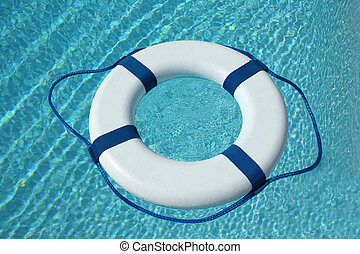Safe - White and blue life buoy in the pool water