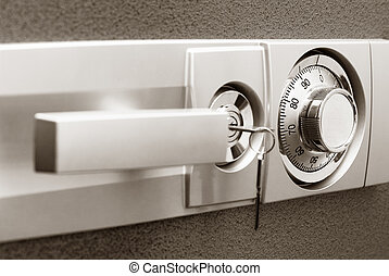 Safe with combination lock, key and knob