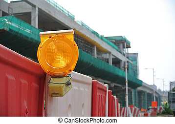 Safety beacon - Warning light at road works site as a...