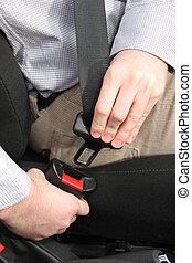 safety belt - details of hands putting on safety belt