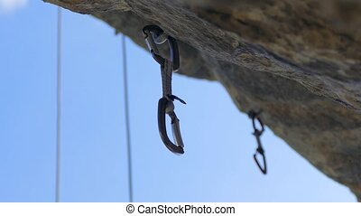 Safety carabiners nailed to the wall for securing the cable...