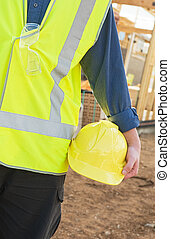 safety equipment - A young worker at the construction site...