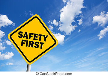 Safety first illustrated sign over blue sky