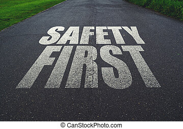 Safety first, message on the road. Concept of safe driving...
