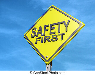 """A yield road sign with """"Safety First""""against a cloudy sky."""