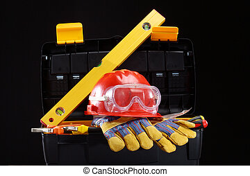 Safety gear kit close up over black