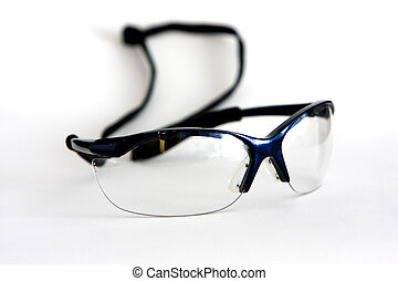 A pair of safety glasses on white background