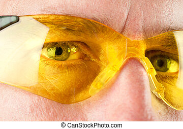 Safety glasses - Close up of a man wearing yellow eye...