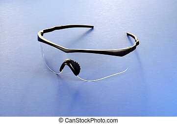 Safety Glasses - Close-up of safety glasses on a blue...