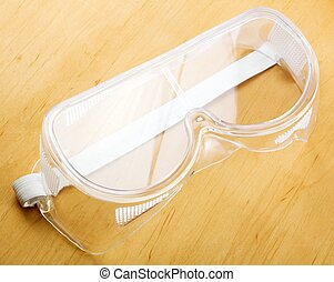 Safety glasses - Industrial safety glasses - over a wooden...