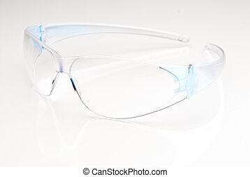 Safety glasses - Modern safetly glasses on a reflective...