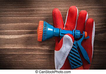Safety glove and water hose nozzle agriculture concept