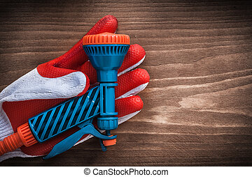 Safety glove and water sprayer agriculture concept