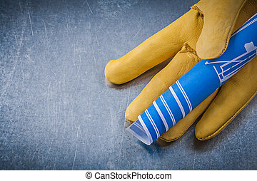 Safety gloves blue engineering drawings on metallic background