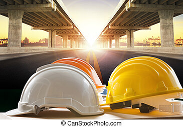 safety helmet on civil engineering working table against...