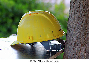 Safety helmet - Yellow safety helmet symbolizing health and...