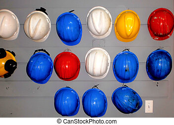 Safety helmets - Colorful assembly of safety helmets on a...
