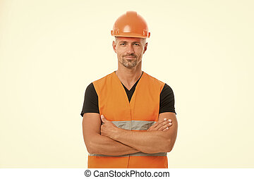 Safety is main point. Man protective hard hat and uniform white background. Worker builder confident looking camera. Protective equipment concept. Builder crossed hands chest. Strong handsome builder