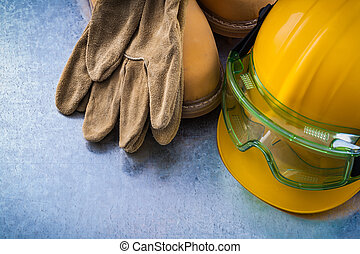 Safety leather boots protective gloves hard hat and...
