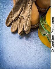 Safety leather shoes protective gloves building helmet and trans