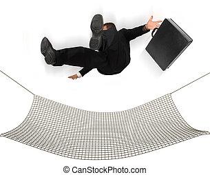 Safety Net - Businessman falling into a safety net on a...