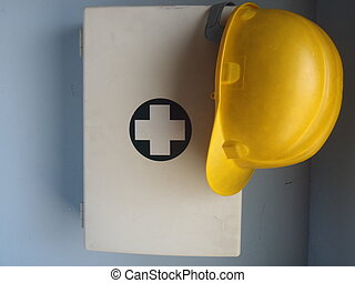 safety prevention - emergency cabinet with yellow helmet...