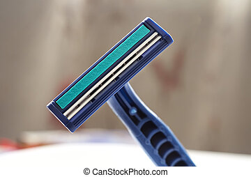 Safety razor. - Safety razor close up on blurred background.